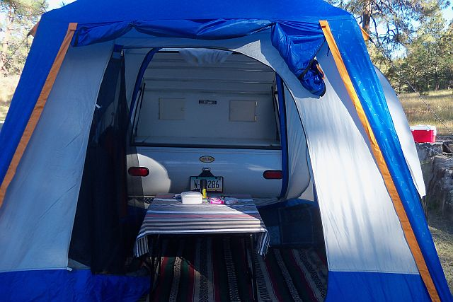 Rain fly of SUV tent rolled up to expose door. Very Cozy indeed..jpg