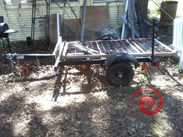 junk trailer, with twin bed frame for size comparison.jpg