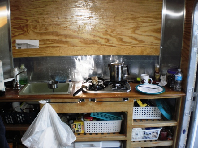 The unfinished Galley at work - coffee and a great burrito on the stove - small.JPG